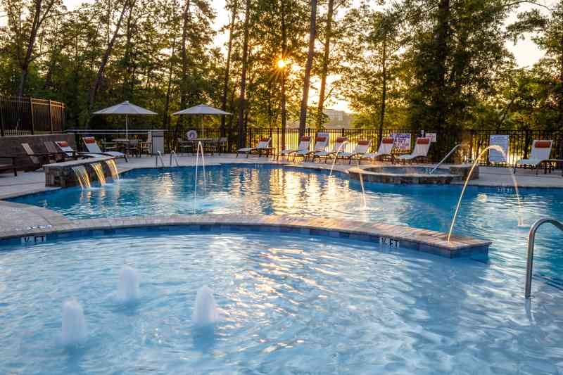 The sun rises over Lake Hartwell and the pool at Lakeside Lodge Clemson.