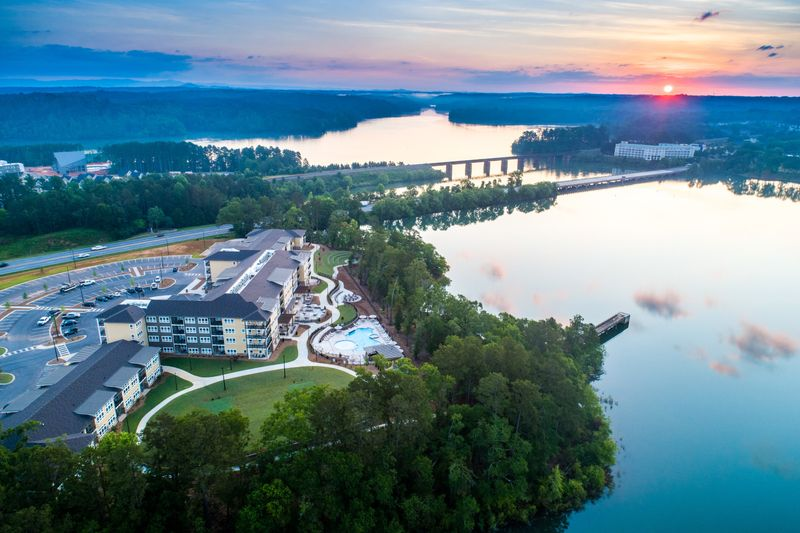 Lakeside Lodge's rec field, pool, firepit, and amphitheater enjoy a waterfront view of a late-spring sunrise over Lake Hartwell.